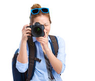 Girl taking picture using digital camera Royalty Free Stock Photos