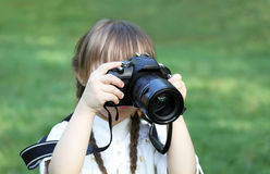 Girl taking pictures Stock Photography