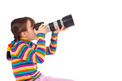 Girl taking pictures. Profile of a little caucasian girl taking pictures with a camera. Image isolated on white studio background Stock Photo
