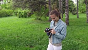 Girl taking pictures with digital camera stock video
