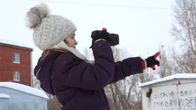 Girl taking pictures of her gloved hand stock video footage