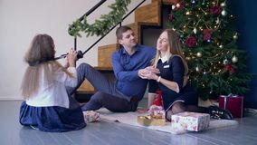 Girl taking pictures of her happy parents at Xmas stock footage