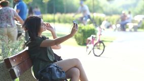 Girl doing selfie in the park