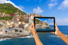 Girl taking pictures on a tablet in Manorola Stock Image