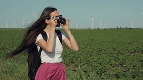 Girl taking pictures with vintage camera stock video