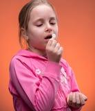 Girl taking pill Royalty Free Stock Photo