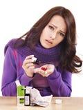 Girl taking pills. Royalty Free Stock Photo