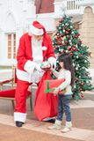 Girl Taking Presents From Santa Claus Stock Images