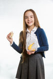 Girl taking sandwich out of lunchbox against white background Royalty Free Stock Image