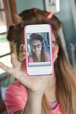 Girl taking self-portrait with cell phone Royalty Free Stock Photos