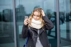 Girl taking a self portrait outdoors in fall Stock Photos