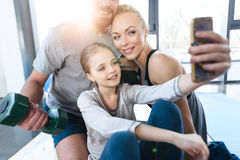 Girl taking self portrait with parents Royalty Free Stock Image