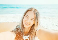 Girl taking selfie on background of sea, pov. royalty free stock photos