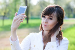 Girl taking selfie Stock Images
