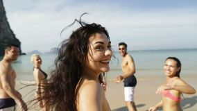 Girl Taking Selfie Of Cheerful People Running In Water On Beach, Happy Young Man And Woman Group Having Fun. Slow Motion 120 stock video