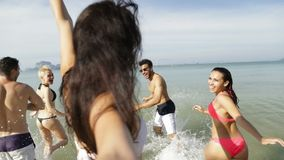 Girl Taking Selfie Of Cheerful People Running In Water On Beach, Happy Young Man And Woman Group Having Fun. Slow Motion 120 stock video footage