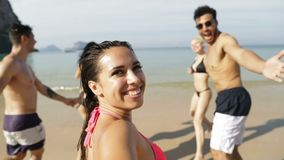 Girl Taking Selfie Of Cheerful People Running In Water Holding Hands On Beach, Happy Young Man And Woman Group Having. Fun Slow Motion 120 stock video