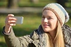 Girl taking selfie Stock Photography