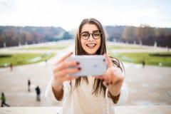 Girl taking selfie on garden background Stock Images