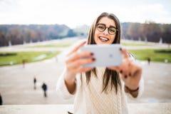 Girl taking selfie on garden background Stock Photography