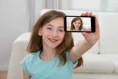 Girl Taking Selfie With Mobile Phone Stock Photography