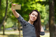 Girl taking selfie outdoors Stock Photos