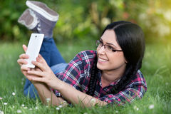 Girl taking selfie in the park Royalty Free Stock Image