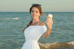 Girl taking selfie photograph using smartphone Stock Photo