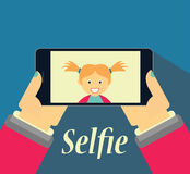 Girl taking selfie picture on her phone Stock Photography