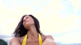 Girl taking selfie on sea. Sexy girl taking selfie on sea stock video