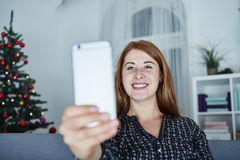 Girl is taking a selfie with smartphone Stock Photos
