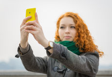 Girl taking a selfie. Stock Photo