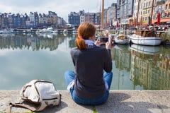Girl taking a shot of Honfleur harbor Royalty Free Stock Image