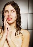Girl taking a shower Stock Image