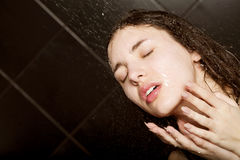 Girl taking a shower Royalty Free Stock Image