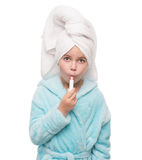 Girl after taking a shower is applying hygienic lipstick on her. Close up portrait of little girl after taking a shower is applying hygienic lipstick on her lips Stock Images