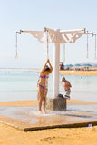 Girl taking a shower. On the shores of the Dead Sea Stock Photography