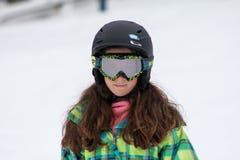 Girl taking a skiing lesson Stock Photos