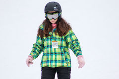 Girl taking a skiing lesson Stock Photo