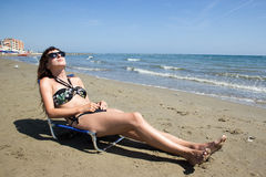 Girl taking sun on the beach Royalty Free Stock Images