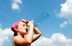 Girl taking a thirsty drink royalty free stock photography