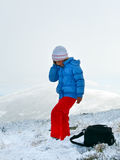 Girl talk by cellphone on mountain winter plateau Stock Photos