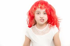 Girl talk in red hair wig talk isolated on white Royalty Free Stock Image