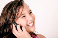 Girl talking. On her mobile phone and smiling. Image space to insert your design or text stock photos
