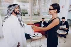 Girl Talking With Arab About Business Partnership.