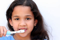 Girl Talking Brushing Teeth Royalty Free Stock Images