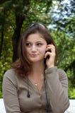 Girl talking cell stock image