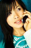 Girl talking cell. Sexy young asian girl talking cell phone Royalty Free Stock Images