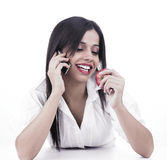 Girl talking in the cell while eating Royalty Free Stock Photography