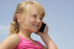 Girl talking on cell phone. A young girl is talking on her phone Stock Images